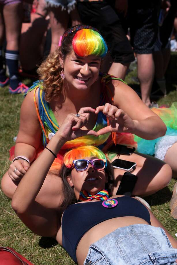 San FranciscoSarah Rabin, top, and Natasha Johnson of Palo Alto make a heart with their hands while hanging out at Civic Center Plaza at the 44th annual San Francisco Gay Pride Parade in San Francisco, Calif. on Sunday, June 29, 2014. Photo: Kevin N. Hume, The Chronicle