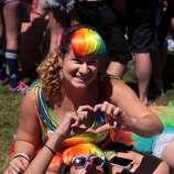 Sarah Rabin, top, and Natasha Johnson of Palo Alto make a heart with their hands while hanging out at Civic Center Plaza at the 44th annual San Francisco Gay Pride Parade in San Francisco, Calif. on Sunday, June 29, 2014.