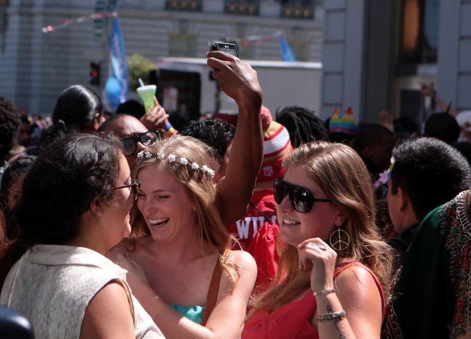 San Francisco Partygoers dance it up near the Wild 94.9 booth along Polk Street near McAllister at the 44th annual San Francisco Gay Pride Parade in San Francisco, Calif. on Sunday, June 29, 2014. Photo: Kevin N. Hume, The Chronicle