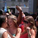 Partygoers dance it up near the Wild 94.9 booth along Polk Street near McAllister at the 44th annual San Francisco Gay Pride Parade in San Francisco, Calif. on Sunday, June 29, 2014.