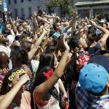 """People danced to the music at a secondary stage south of City Hall after the parade. The annual Gay Pride parade on Market Street was held in San Francisco, Calif. Sunday June 29, 2014 and the theme was """"Color Our World With Pride."""""""