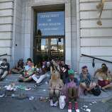 """People used the steps in front of the Public Health building across from City Hall for a rest after the parade. The annual Gay Pride parade on Market Street was held in San Francisco, Calif. Sunday June 29, 2014 and the theme was """"Color Our World With Pride."""""""