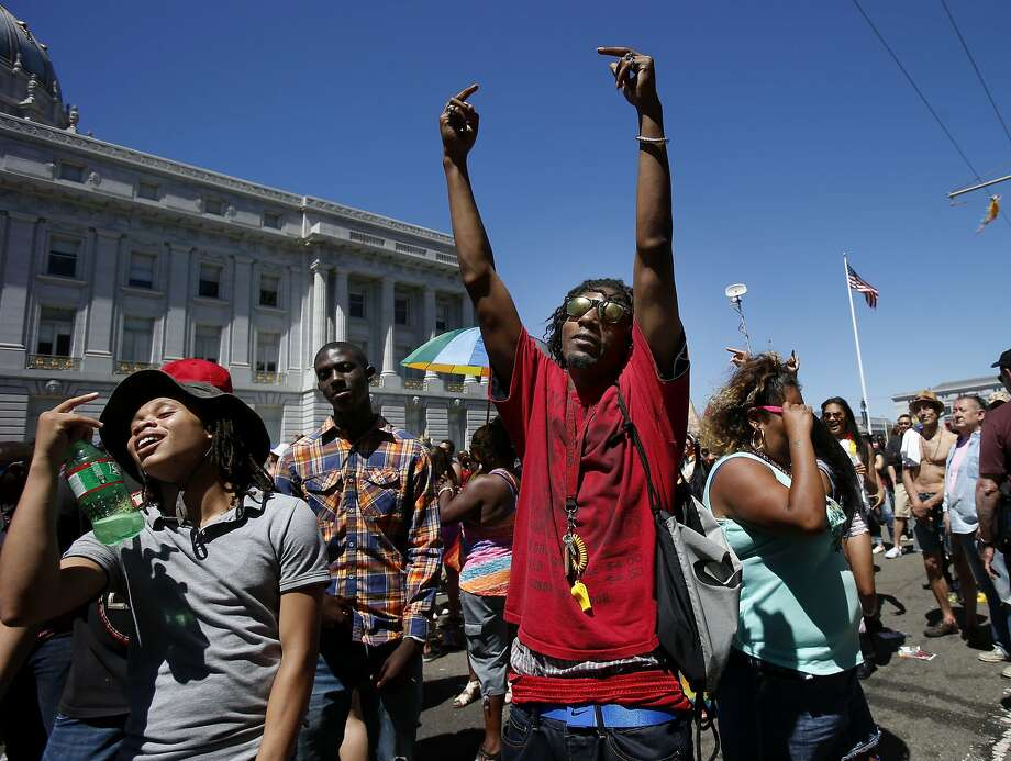 Thousands enjoyed the warm weather at the annual Gay Pride parade on Market Street on Sunday. Monday is forecast to be even warmer. Photo: Brant Ward, San Francisco Chronicle