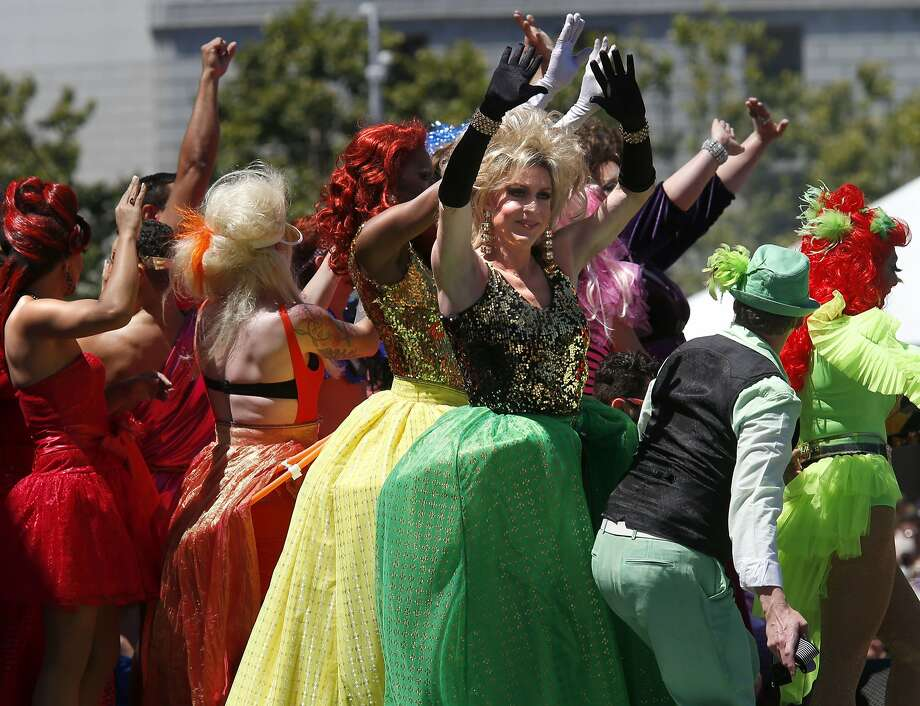 "San FranciscoPerformers like the drag queen extravaganza Cockatelia played to an enthusiastic crowd after the parade. The annual Gay Pride parade on Market Street was held in San Francisco, Calif. Sunday June 29, 2014 and the theme was ""Color Our World With Pride."" Photo: Brant Ward, San Francisco Chronicle"