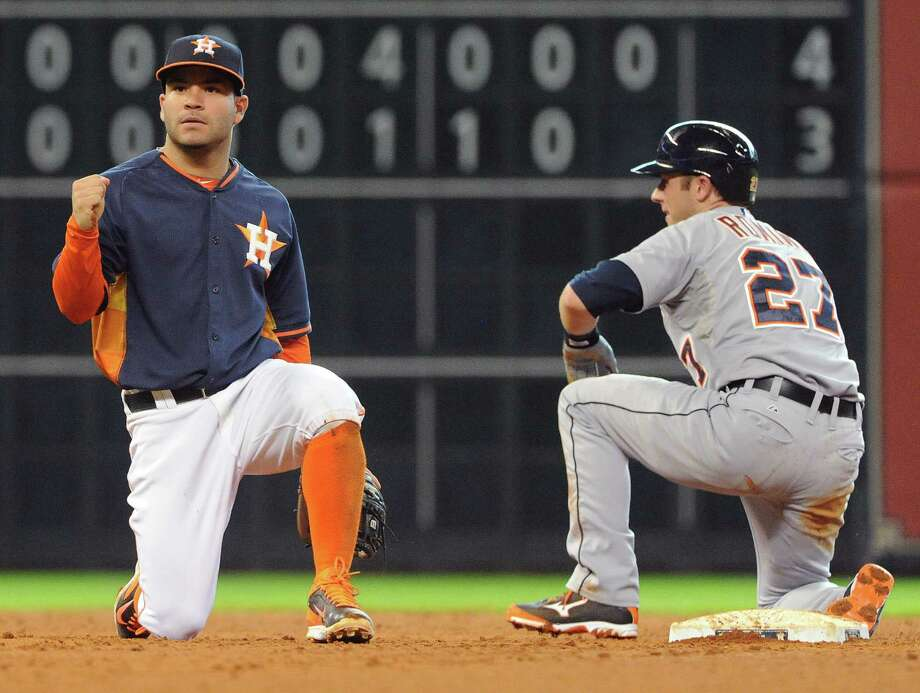 The list of contributions for Jose Altuve, left, Sunday included three hits, two stolen bases and a hand in two double plays - this one in the fifth despite the best efforts of the Tigers' Andrew Romine. Photo: Eric Christian Smith, Freelance / Eric Christian Smith