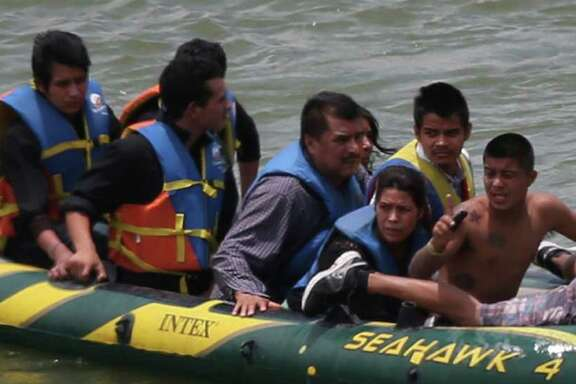 Using an inflatable raft, coyotes, or smugglers, carry immigrants across the Rio Grande near Roma. According to law enforcement officials, some smugglers have moved to other stretches of the river to avoid the saturated border in Hidalgo County.