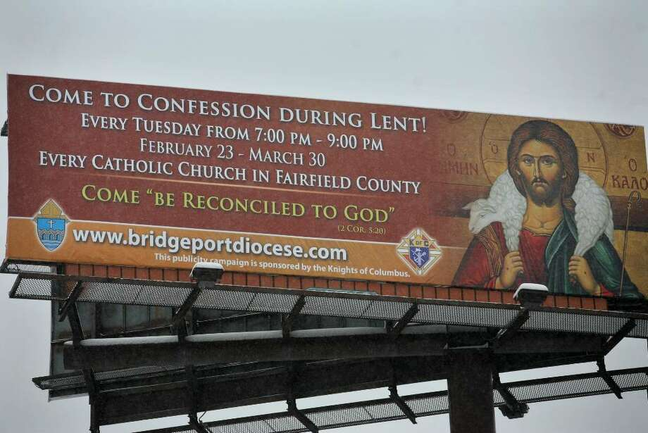 An  I-95 billboard in Bridgeport urges Catholics to come to confession during Lent. Photo: Brian A. Pounds / Connecticut Post