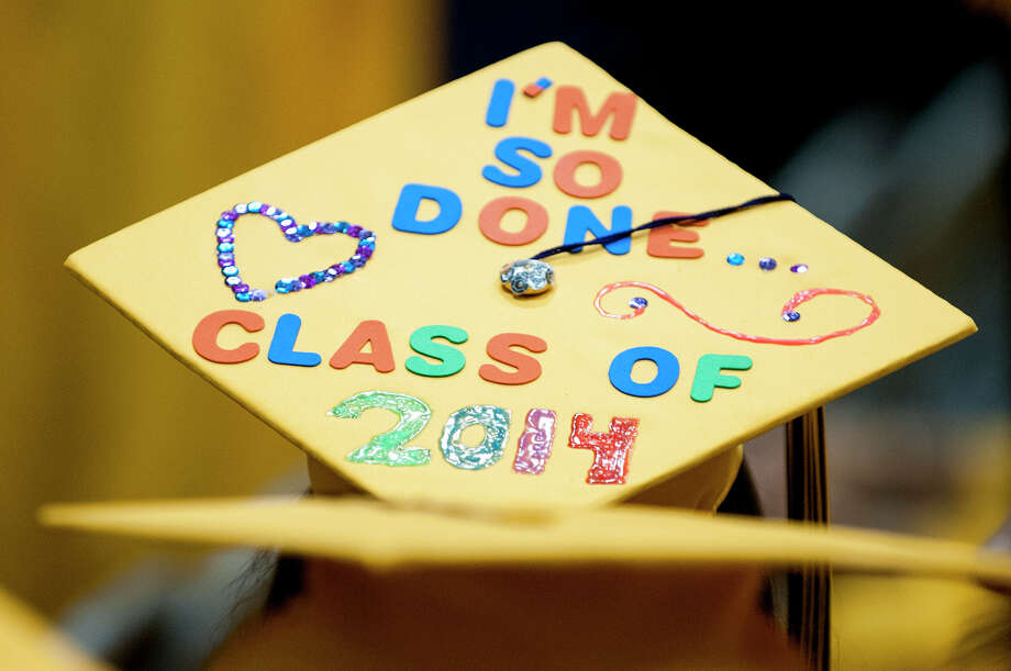 An overhead view of a Troy high school student's decorated graduation cap during graduation commencement at Hudson Valley Community College on Sunday, June 29, 2014, in Troy, N.Y.  (Tom Brenner/ Special to the Times Union) Photo: Tom Brenner / ©Tom Brenner/ Albany Times Union