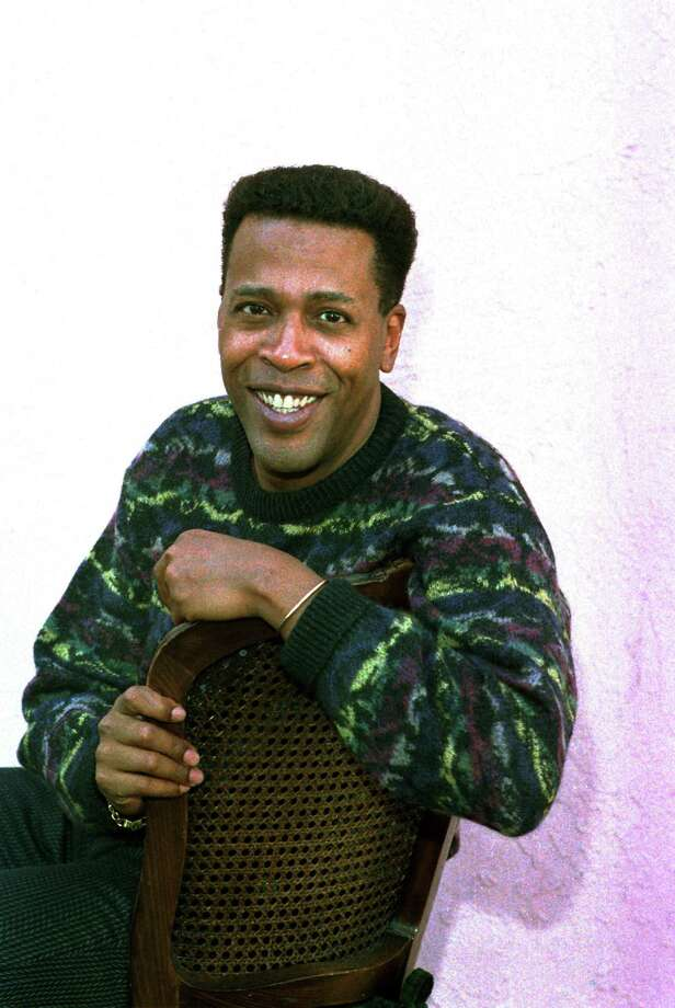 "FILE - In this Jan. 30, 1989 file photo, actor Meshach Taylor poses during an interview in Los Angeles, Calif. Taylor's agent says the actor, who appeared in the hit sitcoms ""Designing Women"" and ""Dave's World"" died of cancer on Saturday, June 28, 2014, at his home in Los Angeles. He was 67.  (AP Photo/Nick Ut, File) Photo: Nick Ut, STF / AP"