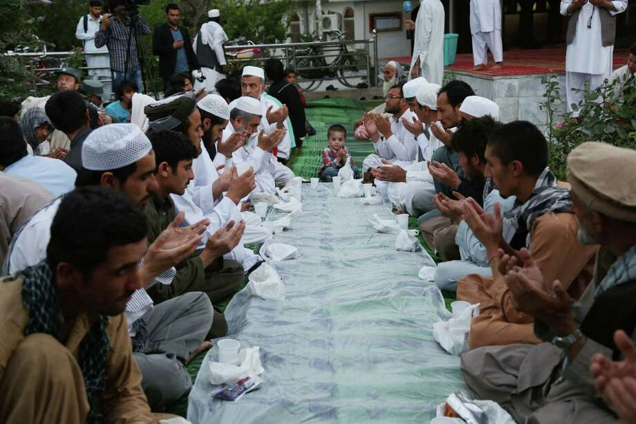 Afghans pray before breaking their fast during the Muslim holy month of Ramadan in Kabul, Afghanistan on Sunday, June 29, 2014. Photo: Rahmat Gul, STR / AP