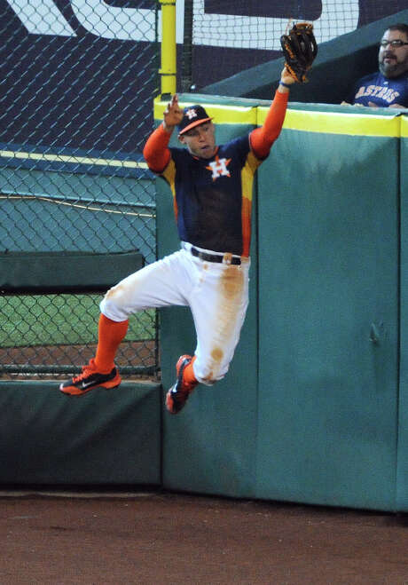 Astros right fielder George Springer shows off his vertical leap in robbing the Tigers' Miguel Cabrera in the sixth inning Sunday. Photo: Eric Christian Smith, Freelance / Eric Christian Smith