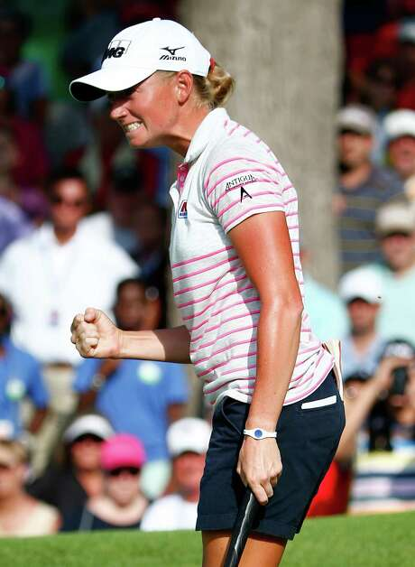 Stacy Lewis shows her grit by making a birdie putt on the final hole Sunday to win the NW Arkansas Champion-ship, something of a home tournament for the University of Arkansas product. Photo: Sam Greenwood, Staff / 2014 Getty Images