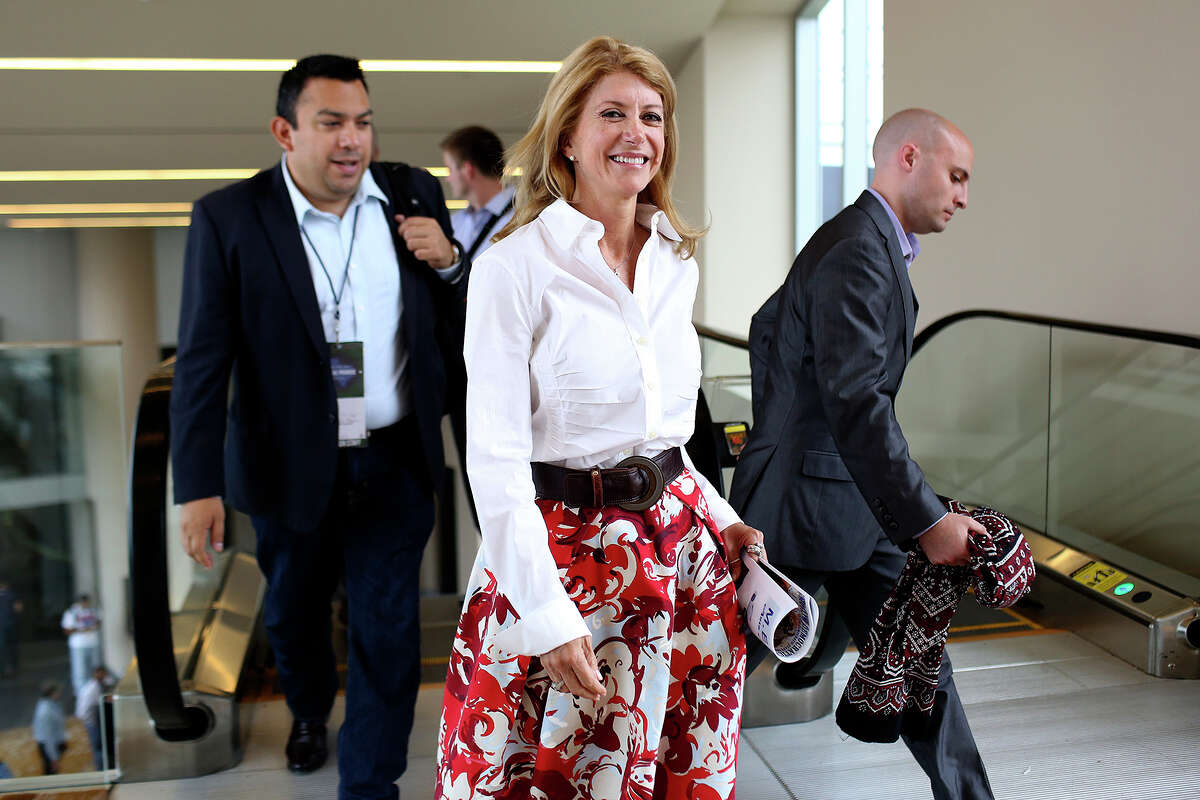 State Senator and candidate for Governor Wendy Davis moves between events with staff members during the Texas Democratic State Convention at the Dallas Convention Center in Dallas on Saturday, June 28, 2014.