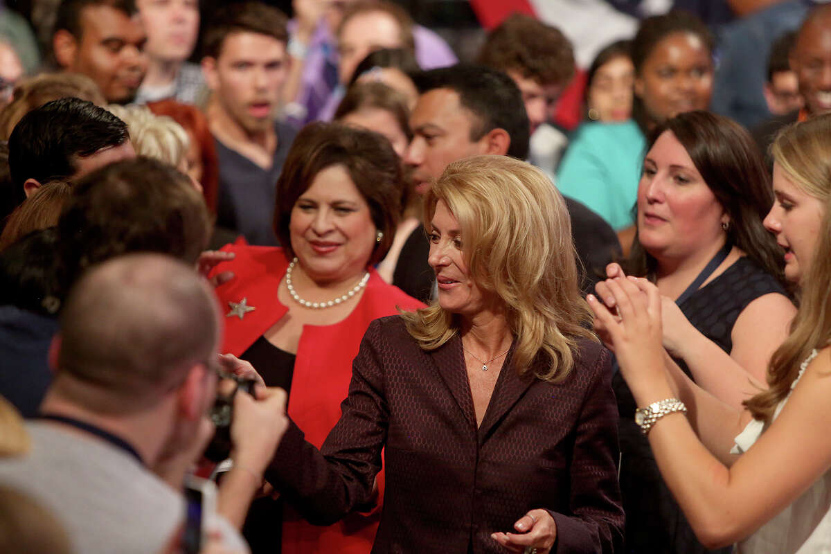 Leticia Van de Putte, State Senator and candidate for Lt. Governor, and Wendy Davis, State Senator and candidate for Governor, greet supporters after their speeches at the Texas Democratic State Convention at the Dallas Convention Center in Dallas on Friday, June 27, 2014.