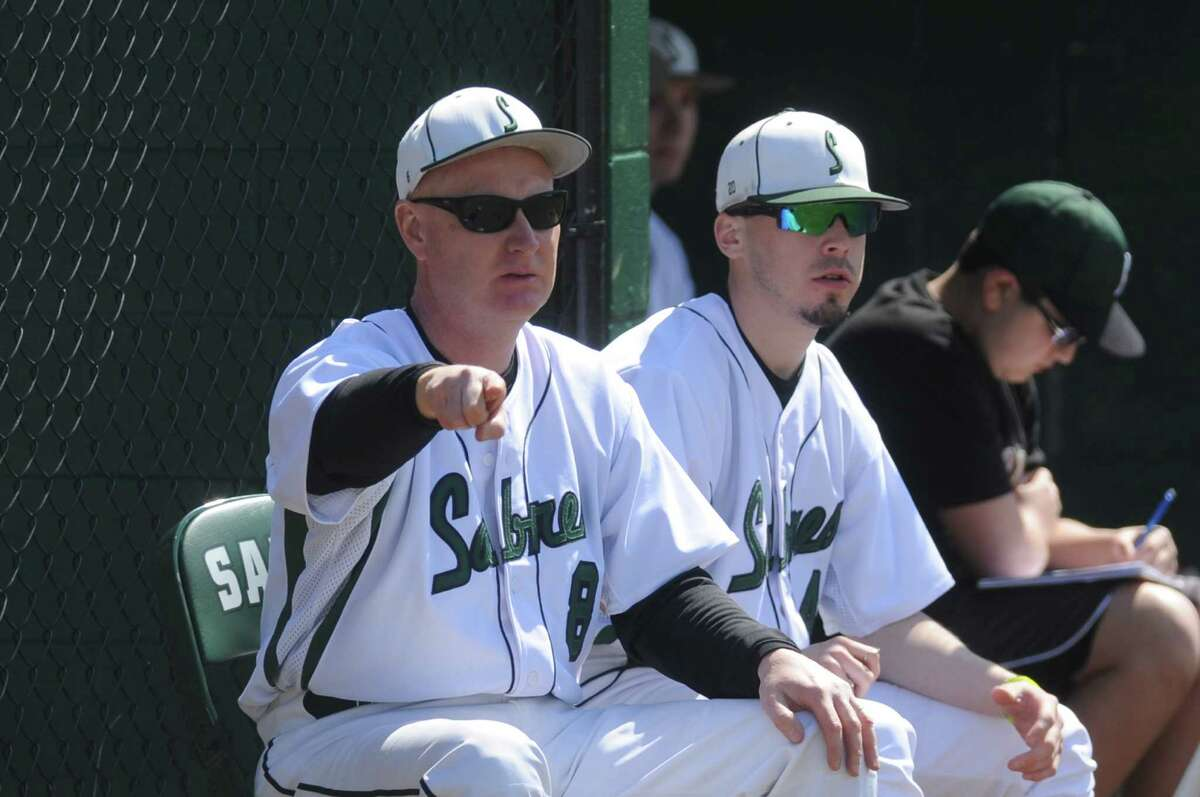 Schalmont coach Bob Anderson, left, during their boy's high school baseball game against Cairo-Durham on Saturday April 12, 2014 in Rotterdam, N.Y. (Michael P. Farrell/Times Union)