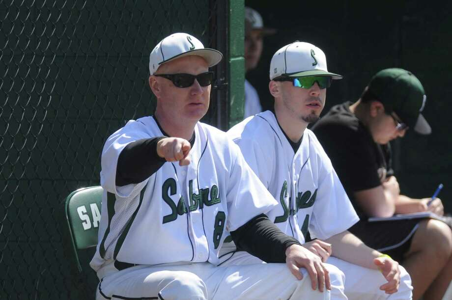 Schalmont coach Bob Anderson, left, during their boy's high school baseball game against Cairo-Durham on Saturday April 12, 2014 in Rotterdam, N.Y. (Michael P. Farrell/Times Union) Photo: Michael P. Farrell / 00026472A