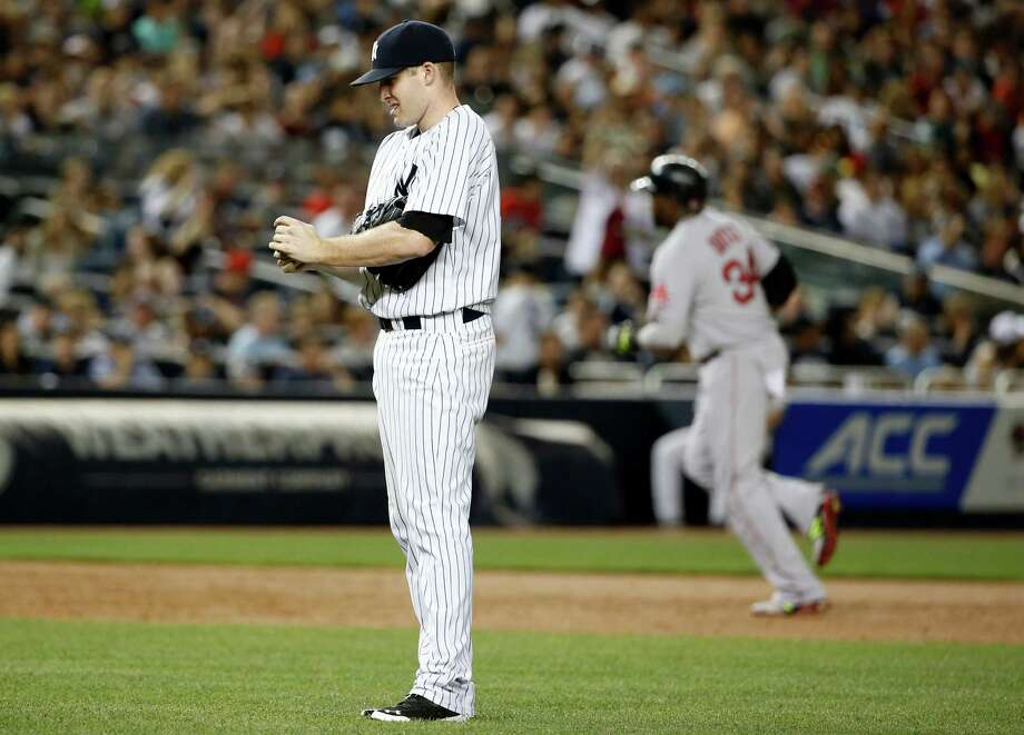 Boston Red Sox designated hitter David Ortiz trots the bases, right, as New York Yankees starting pitcher Chase Whitley reacts after allowing Ortiz a third-inning, three-run home run in a baseball game at Yankee Stadium in New York, Sunday, June 29, 2014.  (AP Photo/Kathy Willens) ORG XMIT: NYY105 Photo: Kathy Willens / AP