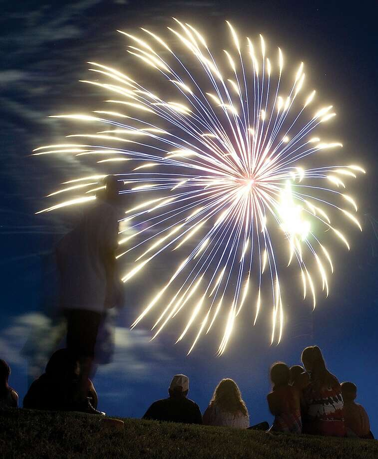 Young and old, men and women enjoy colorful fireworks Saturday, June 28, 2014 at Freedom Fest at Porterville Sports Complex in Porterville, Calif. USA. (AP Photo/The Porterville Recorder, Chieko Hara) Photo: Chieko Hara, Associated Press