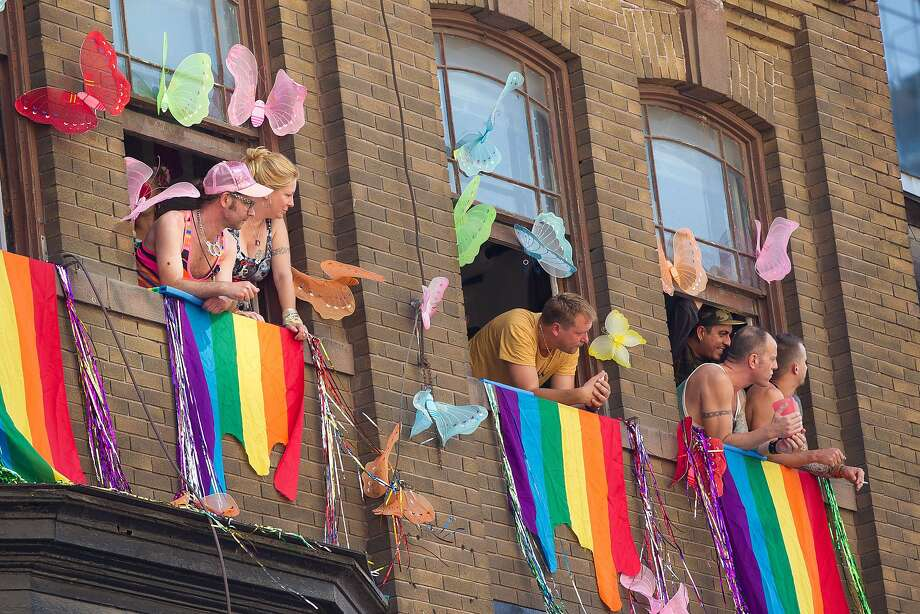 Toronto, CanadaSpectators watch from windows the WorldPride 2014 Parade in Toronto, Canada, June 29, 2014.  WorldPride is an event that promotes lesbian, gay, bisexual and transgender (LGBT pride) issues on an international level through parades, festivals and other cultural activities.  2014 host Toronto is the first WorldPride celebration ever held in North America, and the 4th such festival in the world.  AFP PHOTO / Geoff ROBINSGEOFF ROBINS/AFP/Getty Images Photo: Geoff Robins, AFP/Getty Images