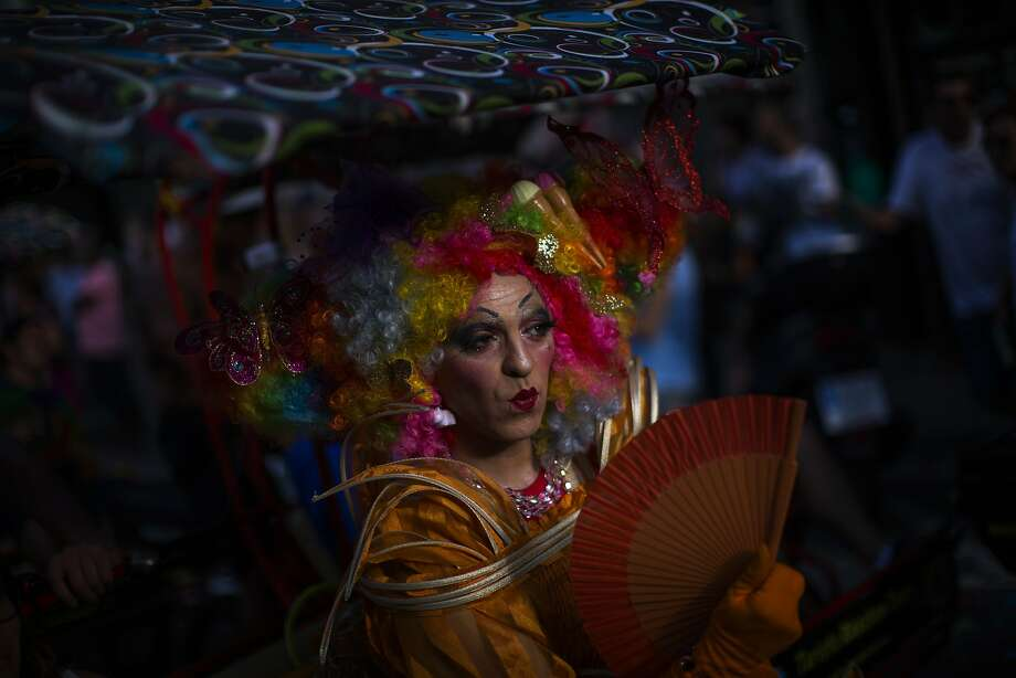 Barcelona, SpainA reveler reacts during the annual Gay Pride march in Barcelona, Spain, Saturday, June 28, 2014. Around the globe, LGBT Pride Month has been marked with parades and marches, festivals and dances. (AP Photo/Emilio Morenatti) Photo: Emilio Morenatti, Associated Press