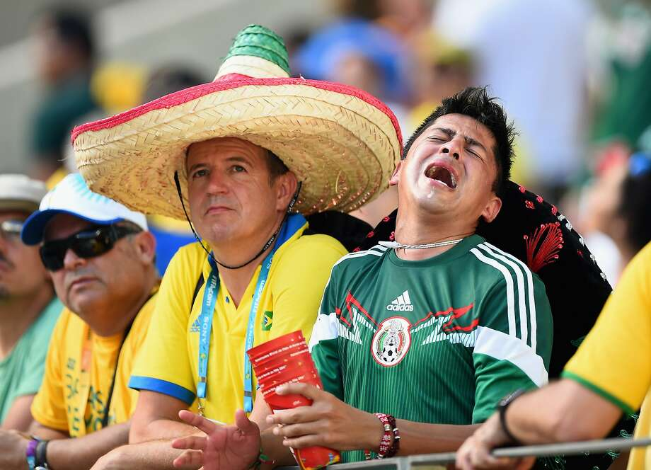 FORTALEZA, BRAZIL - JUNE 29:  A Mexican fan shows his dispair after the 2014 FIFA World Cup Brazil Round of 16 match between Netherlands and Mexico at Castelao on June 29, 2014 in Fortaleza, Brazil.  (Photo by Laurence Griffiths/Getty Images) Photo: Laurence Griffiths, Getty Images
