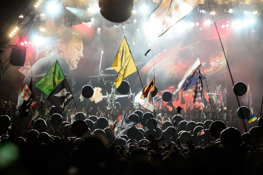 Festivalgoers watch US metal band Metallica perform on the Pyramid Stage, on the second day of the Glastonbury Festival of Music and Performing Arts in Somerset, southwest England, on June 28, 2014. AFP PHOTO / LEON NEALLEON NEAL/AFP/Getty Images Photo: Leon Neal, AFP/Getty Images