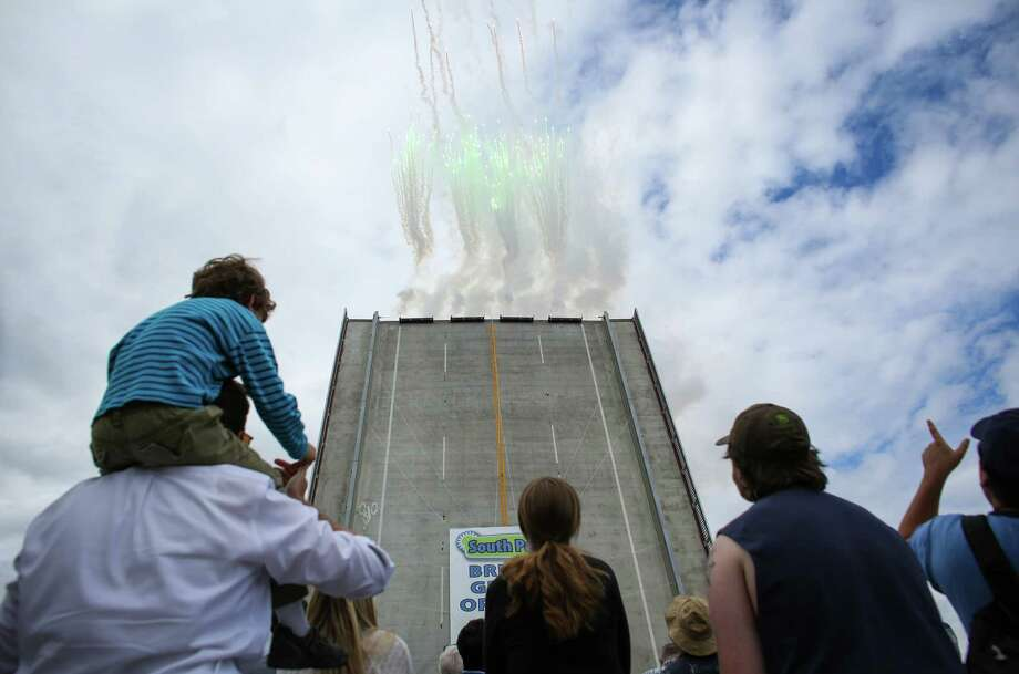 Frireworks erupt from the bridge deck during a celebration of the completion of the new South Park Bridge over the Duwamish River. Since 2010, the bridge in the South Park Community had been closed after it was deemed unsafe. The new bridge is much sturdier than the previous bridge. Photographed on Sunday, June 29, 2014. Photo: JOSHUA TRUJILLO, SEATTLEPI.COM / SEATTLEPI.COM