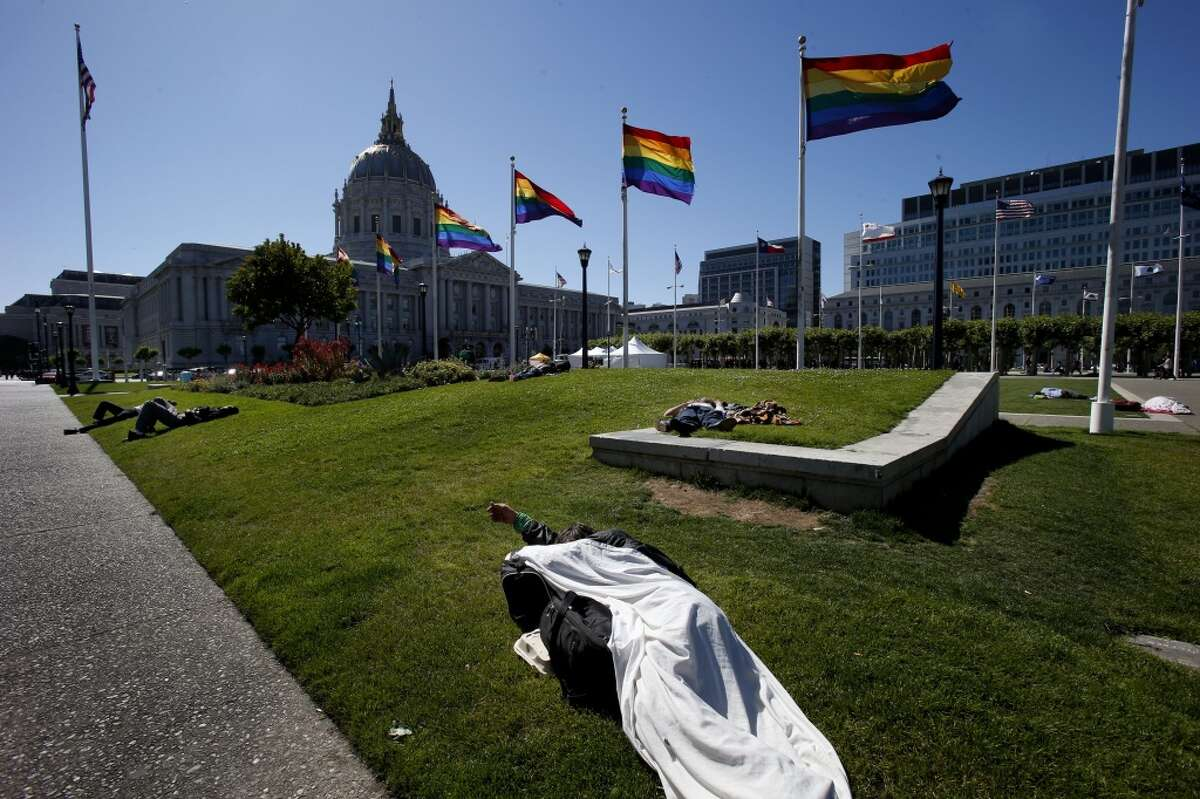 On any given day, a number of homeless people can be seen sleeping in the City Hall park area during daylight hours.