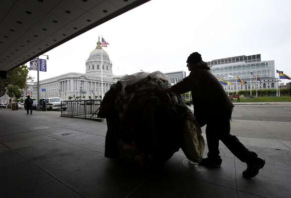 Dave, a homeless man for ten years in San Francisco, pushed his cart past the Bill Graham auditorium.