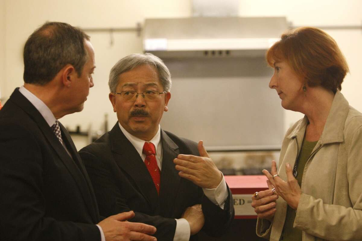 Bevan Dufty (left) and Mayor Ed Lee speak with Sherilyn Adams, Executive Director at Larkin Street Youth Services, on January 27, 2012.