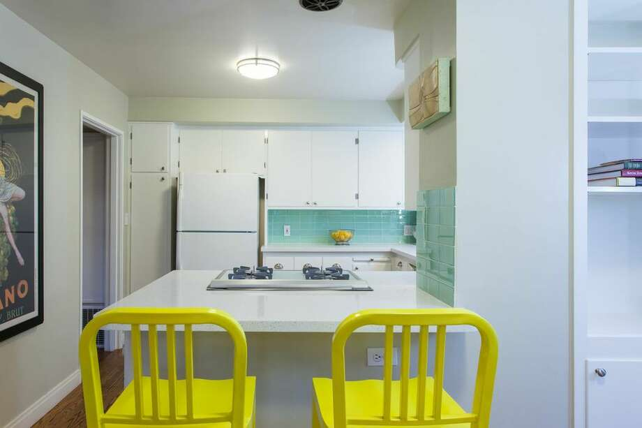 The eat-in kitchen has quartz countertops. Photo: Peter Lyons Photo
