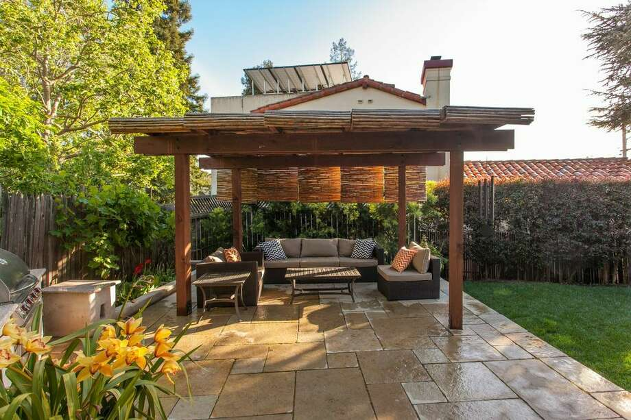 The private backyard pergola with built-in barbecue Photo: Peter Lyons Photo