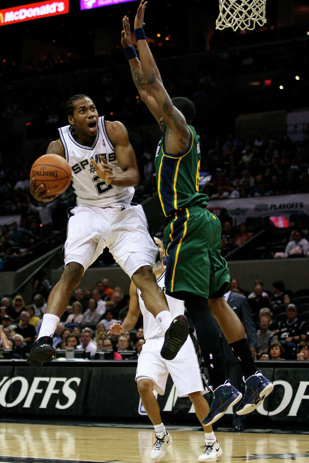 Spurs Kawhi Leonard drives to the goal through Utah Jazz Josh Howard during the first half of game two of the Western Conference first round at the AT&T Center, Sunday, May 2, 2012. Photo: Jerry Lara, San Antonio Express-News / © San Antonio Express-News
