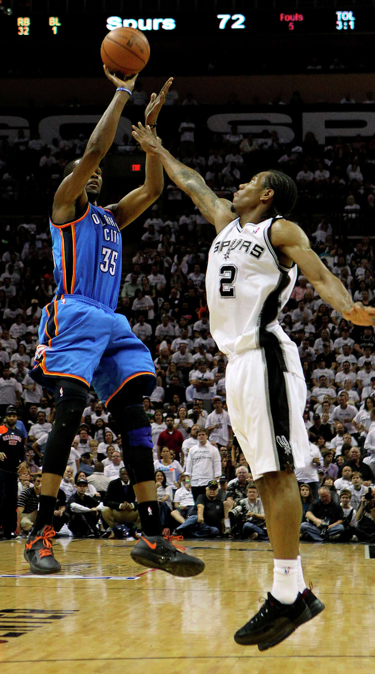 Thunder's Kevin Durant (35) shoots over Spurs' Kawhi Leonard (2) during the second half of Game 5 of the NBA Western Conference Finals in San Antonio, Texas on Monday, June 4, 2012.