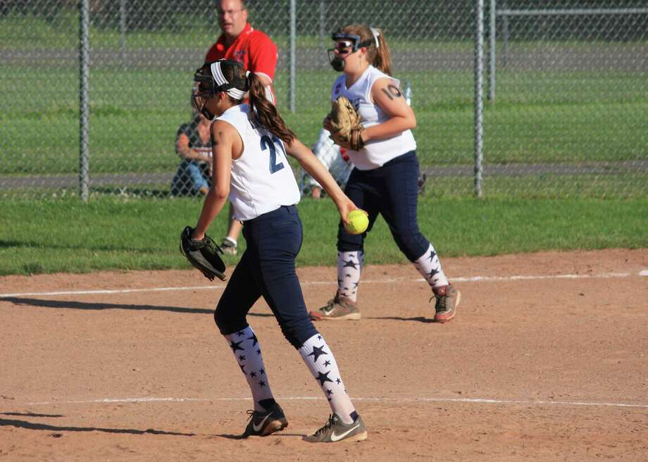 Westport U12 softball pitcher Sophia Alfero, center, fires a pitch during a game against Fairfield on June 24. Westport won the game 8-6 and defeated Fairfield 14-13 in 13 innings June 28 to clinch the District 2 championship. Photo: Contributed Photo / Westport News Contributed
