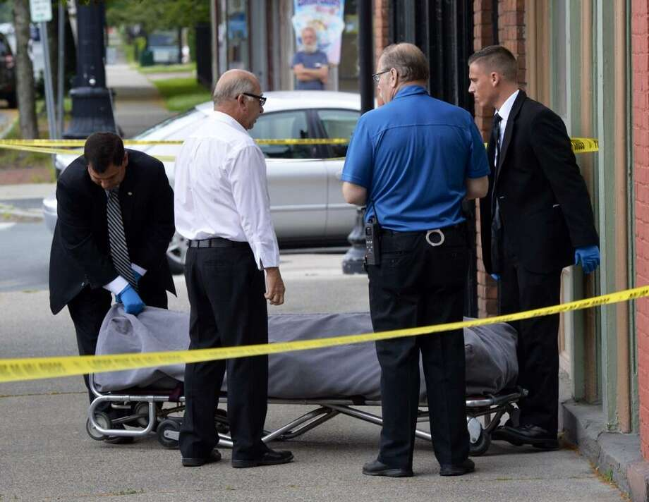 The body of a shooting victim is removed 603 Second Ave., Troy. A man who says is in his 40s was found dead in the apartment early Monday morning. (Skip Dickstein/ Times Union)