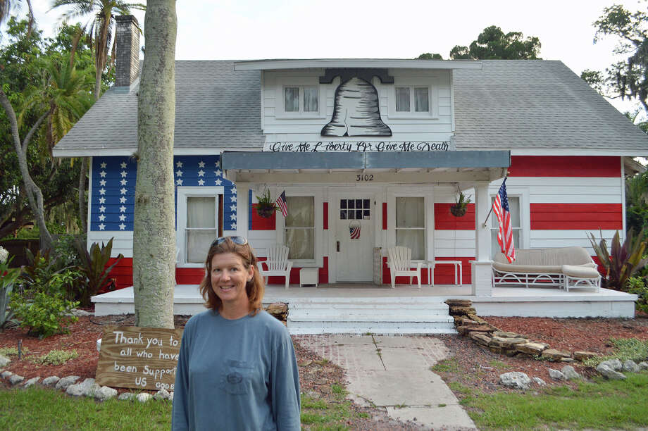"A Florida homeowner and artist is planning on painting the sides of her house with more patriotic imagery, according to Robert Carley, who captured the image while on a recent road trip. ""I especially like the Patrick Henry quote inscribed above the entrance, 'Give me liberty, or give me death!'"" said Carley. Photo: Contributed Photo, Contributed / Darien News"