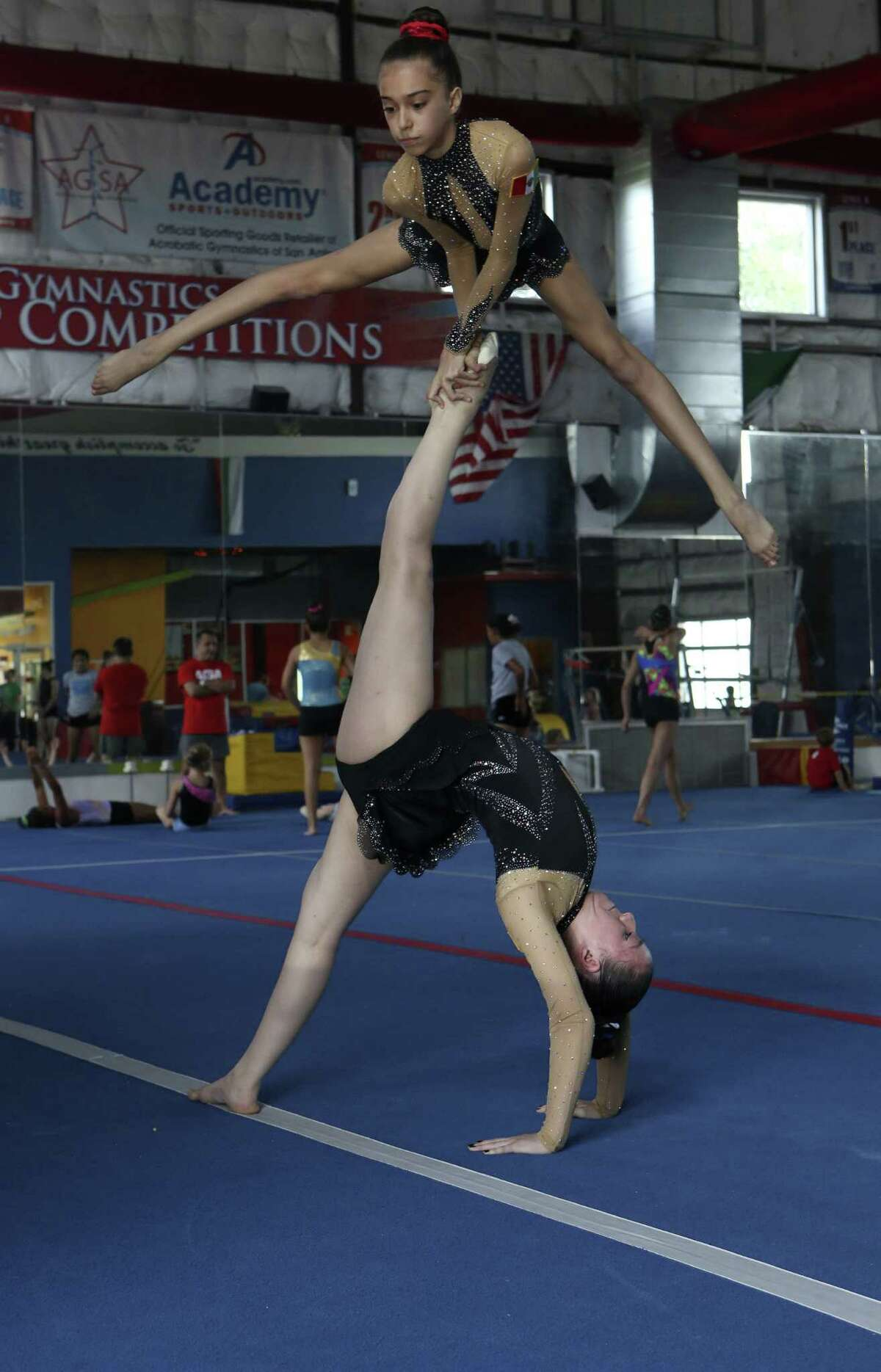 San Antonio acrobats Isabella Melendez, 13, (above) and Ani Caballero, 16, will represent Mexico at the 2014 Acrobatic Gymnastics World Championships in Paris, France July 2 - 5.