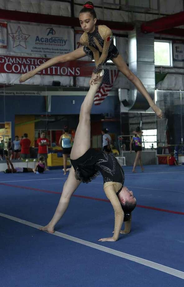 San Antonio acrobats Isabella Melendez, 13, (above) and Ani Caballero, 16, will represent Mexico at the 2014 Acrobatic Gymnastics World Championships in Paris, France July 2 - 5. Photo: Helen L. Montoya / Conexión / ©2014 San Antonio Express-News