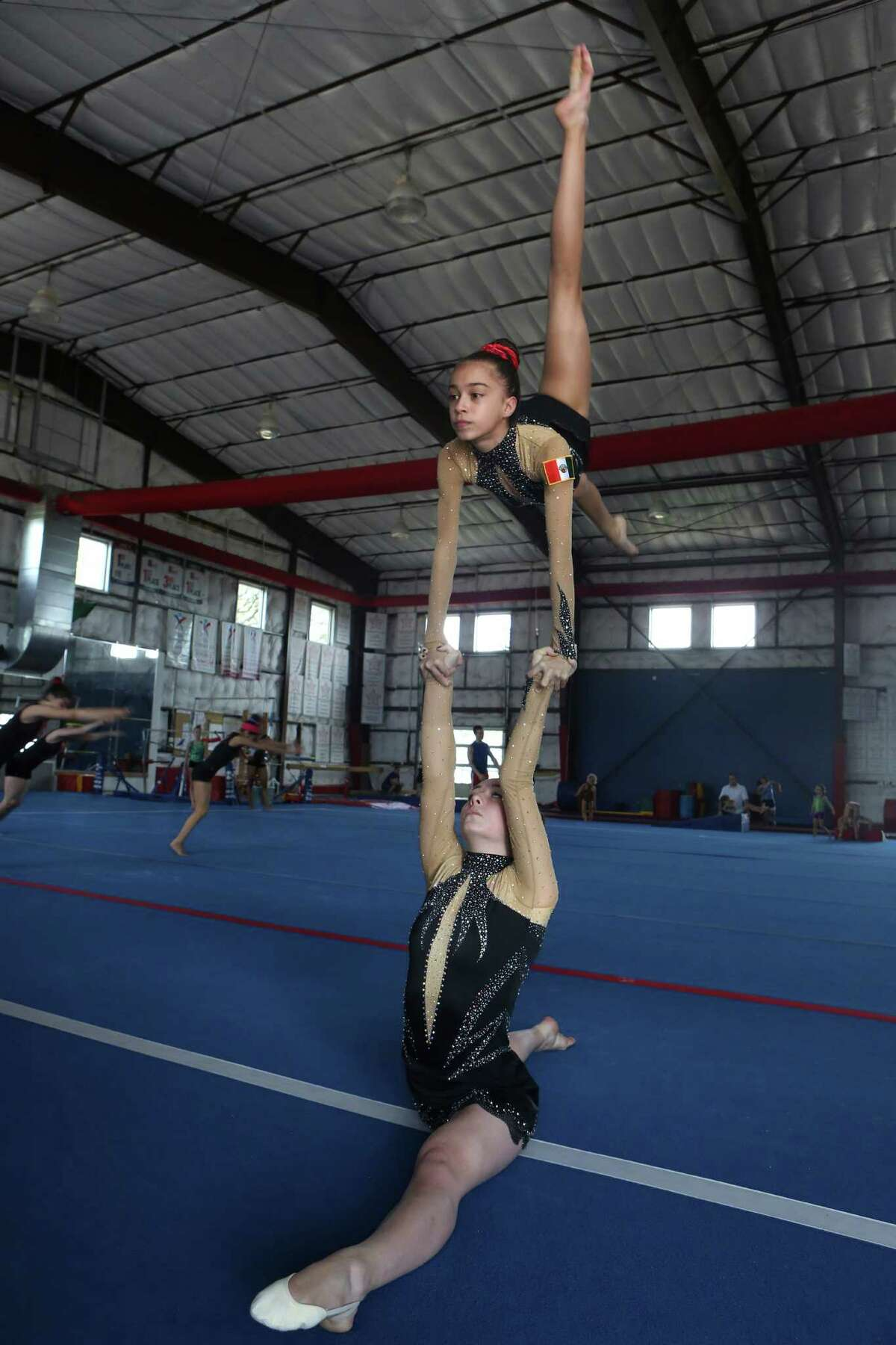 Acrobats Isabella Melendez, 13, and Ani Cavallero, 17 will represent Mexico at the 2014 Acrobatic Gymnastics World Championships in Paris, France July 2 - 5. The girls became Team Mexico when the coach of their gym, Vladimir Vladiv paired them together two years ago to boost participation in the sport from countries around the world. The girls practice three routines five hours a day, work that's paid off with 15 gold medals from local, regional, state and national competitions.