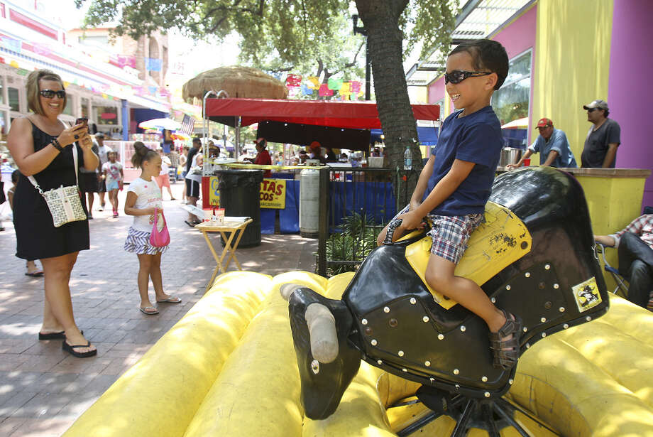 Take a ride at the Freedom Fest, the annual 4th of July celebration at Market Square, this weekend. Photo: Express-News File Photo / SAN ANTONIO EXPRESS-NEWS