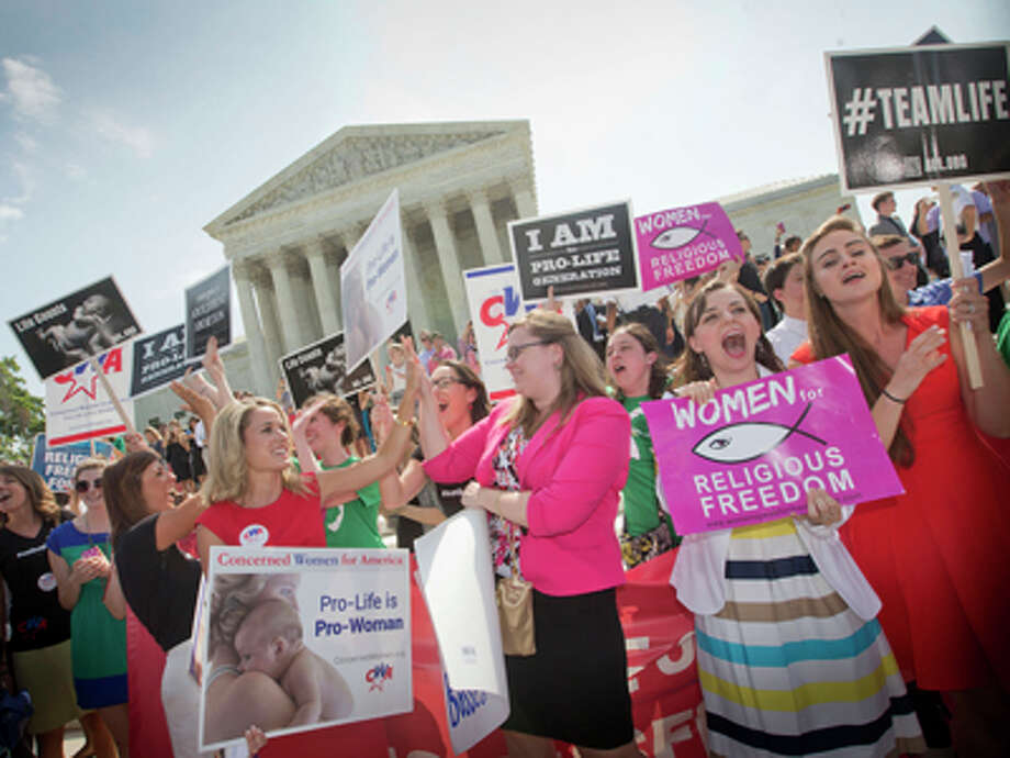 Justices: Can't make employers cover contraceptionThe Supreme Court ruled that some corporations can hold religious objections that allow them to opt out of the new health law requirement that they cover contraceptives for women.The justices' 5-4 decision is the first time that the high court has ruled that profit-seeking businesses can hold religious views under federal law. And it means the Obama administration must search for a different way of providing free contraception to women who are covered under objecting companies' health insurance plans.Read the full ruling in Burwell v. Hobby Lobby Stores, Inc. Photo: Pablo Martinez Monsivais, AP / AP