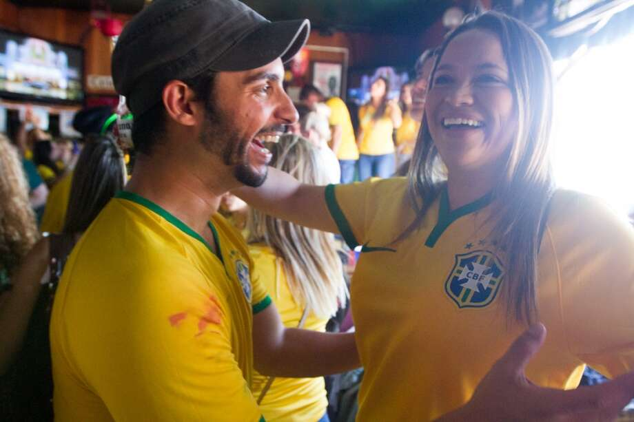It was a wild weekend for soccer fans thoughout the Bay Area. Brazilian fans breathed a sigh of relief and celebrated their penalty shoot-out victory over Chile on Saturday afternoon at Ireland's 32 in San Francisco. Photo: Douglas Zimmerman, Courtesy