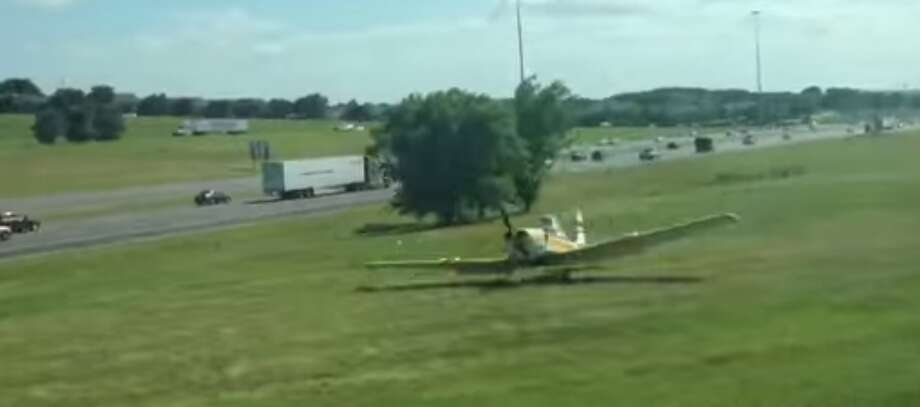 A single engine plane made an emergency landing in on U.S. 287 in Arlington on June 27, 2014. Screenshot from Sean Short's video posted to YouTube. Photo: Courtesy, Sean Short YouTube