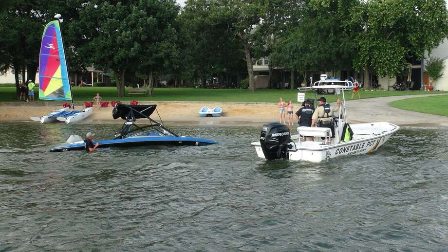 11 people were rescued after their boat sank on Lake Conroe. It seems they did not put the plug in before taking to the water.  Lake Conroe was busy with boaters taking advantage of a dry spell in the cloudy weekend. Photo: Montgomery County Police Reporter
