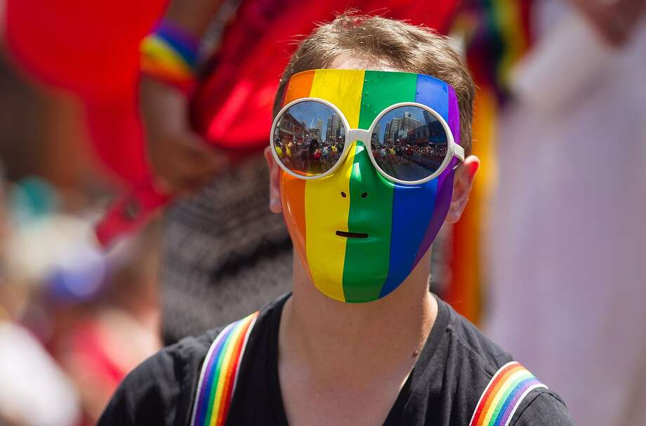 Toronto, OntarioA participant with a rainbow mask sits on the back of a float during the WorldPride Parade in Toronto, Ontario, Canada, June 29, 2014.  WorldPride is an event that promotes lesbian, gay, bisexual and transgender (LGBT pride) issues on an international level through parades, festivals and other cultural activities.  2014 host Toronto is the first WorldPride celebration ever held in North America, and the 4th such festival in the world.  AFP PHOTO / Geoff ROBINSGEOFF ROBINS/AFP/Getty Images Photo: Geoff Robins, AFP/Getty Images