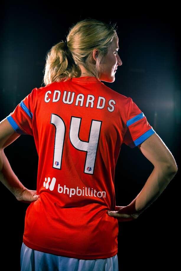 Dash midfielder Becky Edwards shows off the team's new partnership with BHP Billiton.(Anthony Vasser/Houston Dynamo)