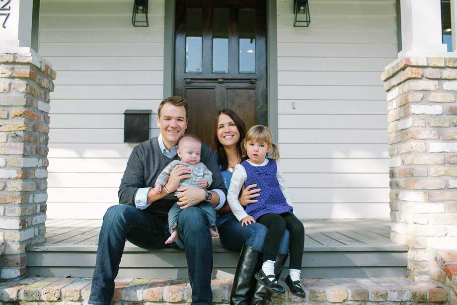 After seven years abroad, Jason and Nicole Vogler (with their kids) built a modern version of a craftsman home in the Heights. Photo: Brooke Schwab