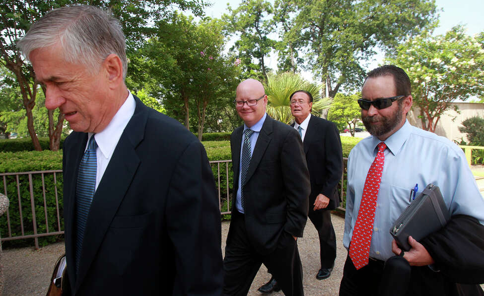 Former State District Judge Angus McGinty (center, bald) enters the Federal Courthouse Monday June 30, 2014 in San Antonio. McGinty is charged with accepting bribes.