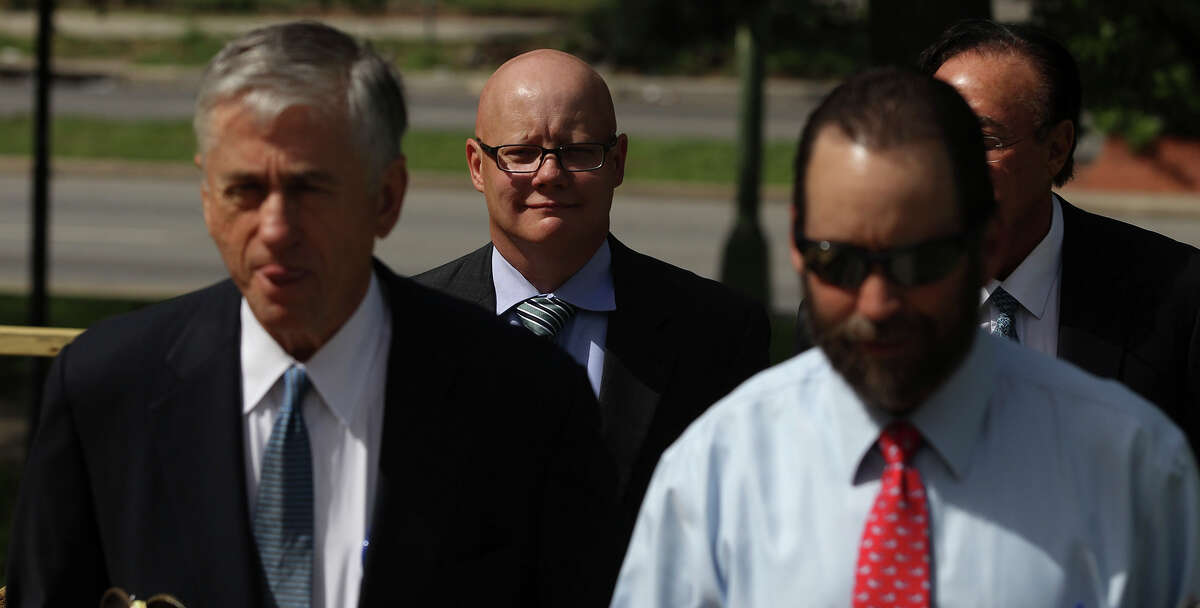Former State District Judge Angus McGinty (center, bald) wals to the Federal Courthouse Monday June 30, 2014 in San Antonio. McGinty is charged with accepting bribes.